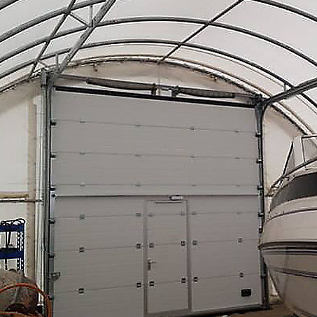 sectional gate in a tent hangar ULA